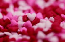 Close up image of pink, white, and red felt hearts
